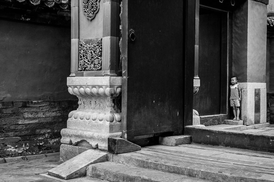 Black & white photo of young boy in the Forbidden City, Beijing, China
