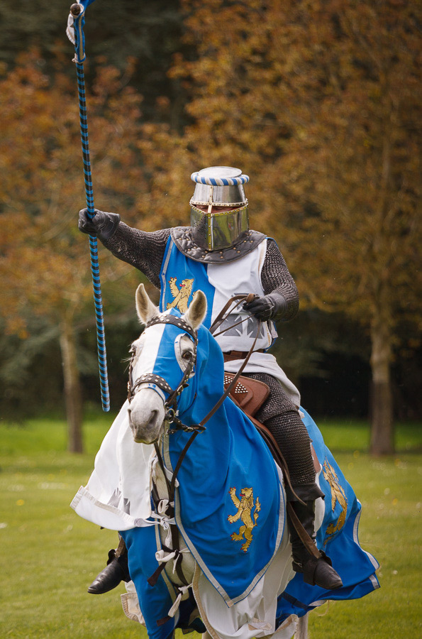 A photo taken in shutter priority of a knight riding a horse in a jousting tournament at Blenheim Palace, Oxfordshire.