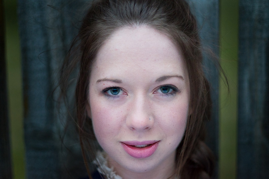 Portrait of young woman taken with prime lens at a wide aperture using contrast detection autofocus