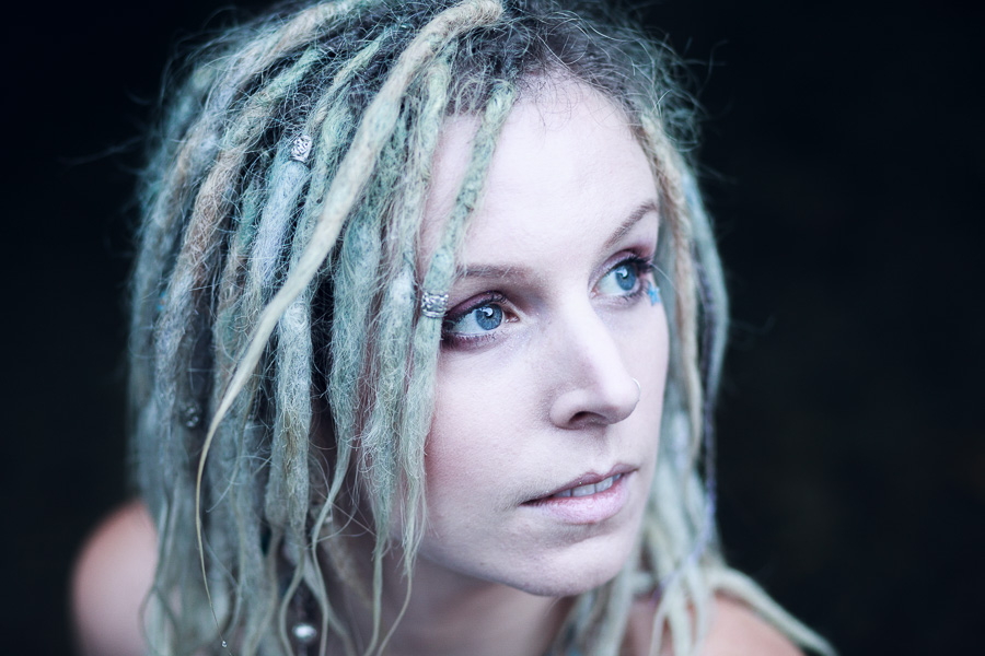 Portrait of woman with dreadlocks in simplified composition