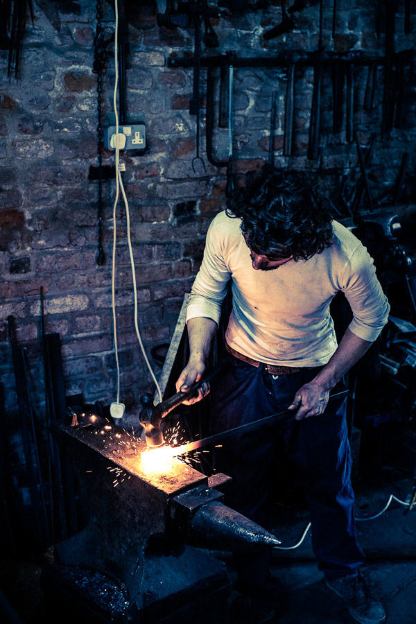 A blacksmith working in a traditional forge in Spalding, Lincolnshire