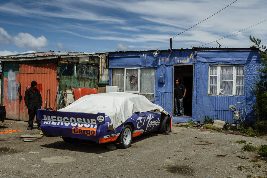 Street photo of two men with a sports car taken in Punta Arenas, Chile
