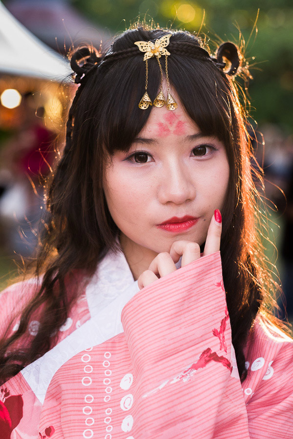 Street photo of girl in cosplay costume taken at Auckland Lantern Festival