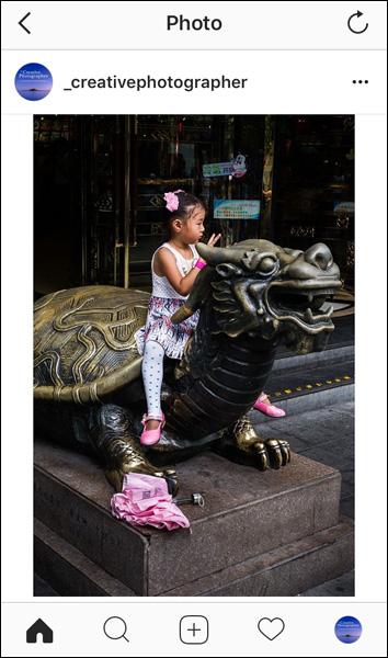 Street photo of girl sitting on a turtle in Shanghai, China displayed in Instagram