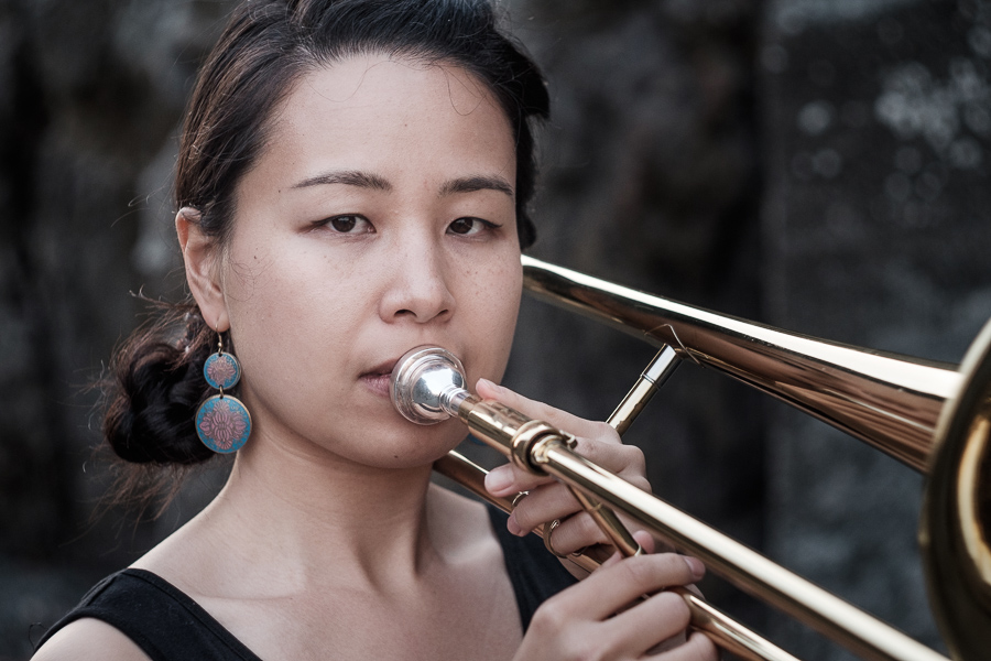 Portrait of woman playing trombone made with Helios 58mm f2 vintage lens