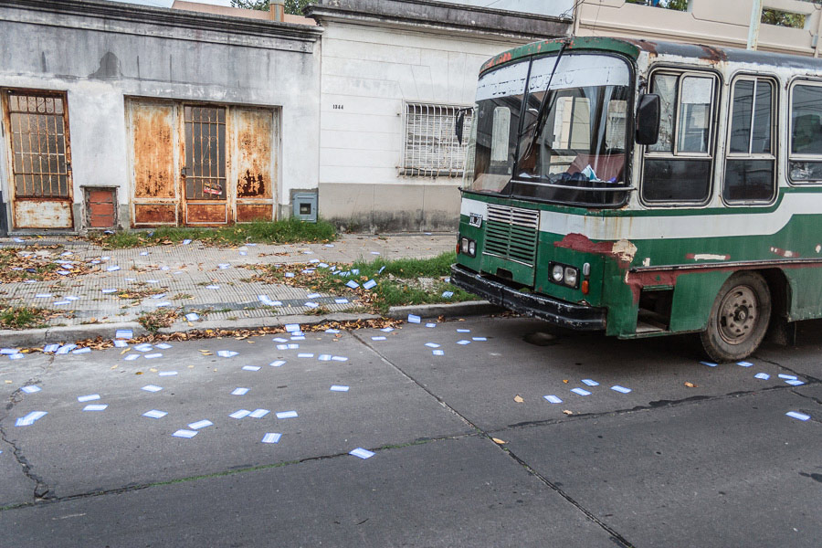 A green bus in a street in La Plata, Argentina photographed with a wide-angle lens