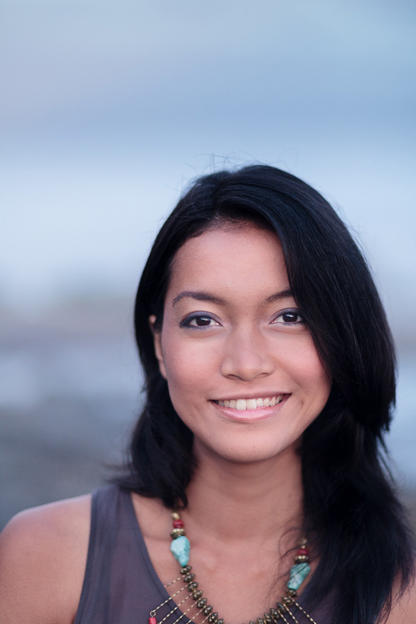 Portrait of an Asian woman made with 85mm prime lens at a wide aperture using center cross-type AF point